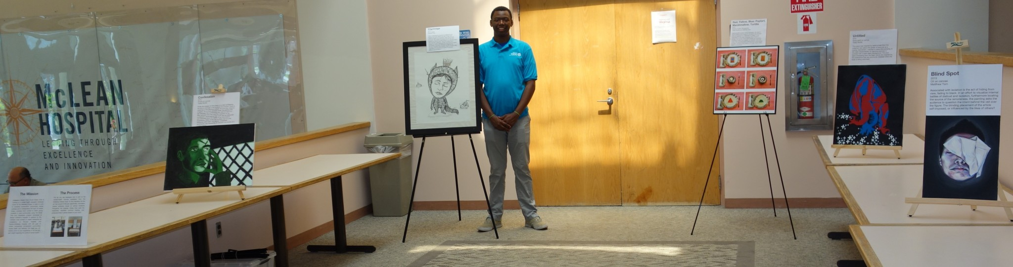 Interact member Joey Kinyanjui presenting art on emotional wellness at McLean Hospital